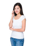 Young woman talk to mobile phone Royalty Free Stock Photos