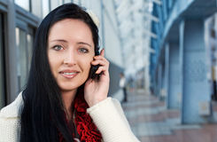 Young woman talk to phone Stock Images