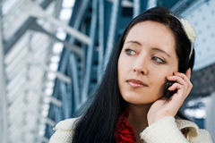 Young woman talk to phone Royalty Free Stock Photos