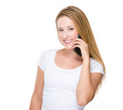 Young Woman talk to phone Royalty Free Stock Photo
