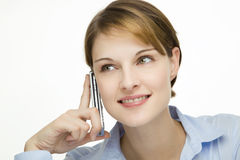 Young woman talking on a cell phone Royalty Free Stock Photo