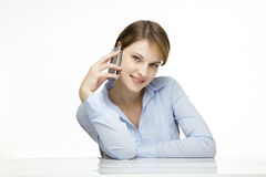Young woman talking on a cell phone. Young businesswoman talking on a mobile phone Stock Photography