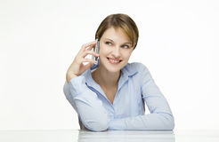 Young woman talking on a cell phone. Young businesswoman talking on a mobile phone Stock Photos