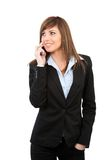 Young woman talking on cell phone isolated Stock Photography