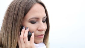 Young woman talking on cell phone outdoor Royalty Free Stock Photography