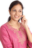Young woman talking on cellphone Stock Image