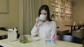 Young woman talking on cellphone in cafe stock video footage