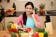 Young woman talking on cellphone Royalty Free Stock Image