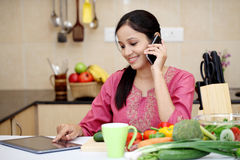 Young woman talking on cellphone Stock Images