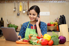 Young woman talking on cellphone Stock Photos