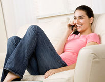 Young woman talking on celular phone Royalty Free Stock Image