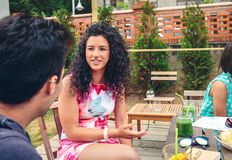 Young woman talking with friend in a summer day Stock Images
