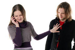 Young woman is talking gossip. And secret by mobile phone near her boyfriend stock images