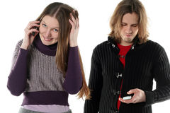 Young woman is talking gossip. And secret by mobile phone near her boyfriend stock photos