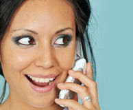Young woman talking on her cell phone Royalty Free Stock Images