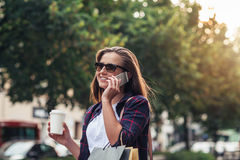 Young woman talking on her cellphone while shopping Royalty Free Stock Photos