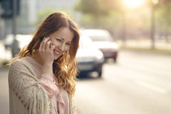 Young woman talking on her mobile Royalty Free Stock Image