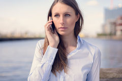 Young woman talking on her mobile phone Royalty Free Stock Images