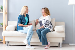 Young woman talking with her parent Royalty Free Stock Photography