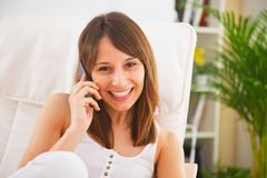 Young woman talking with her smartphone Royalty Free Stock Images