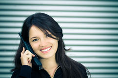 A young woman talking on a home wireless phone. Royalty Free Stock Photos