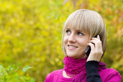 Young woman talking on mobile Stock Image