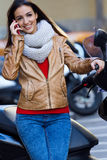 Young woman talking on mobile in the city Stock Photos