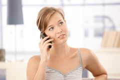Young woman talking on mobile at home Royalty Free Stock Photo