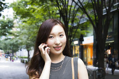 Young woman talking with a mobile phon Stock Photos