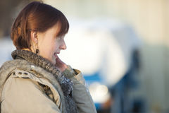 Young woman talking on the mobile phone Stock Photography