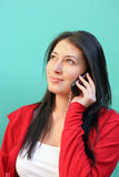 Young woman talking on mobile phone stock photography