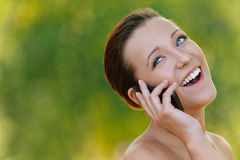 Young woman talking on mobile phone Stock Photos