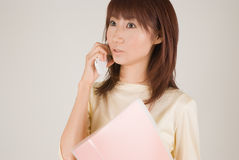 Young woman talking with mobile phone. Young businesswoman talking with mobile phone Stock Photography