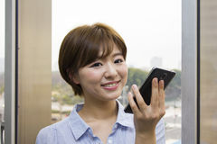 Young woman talking with a mobile phone Stock Photography