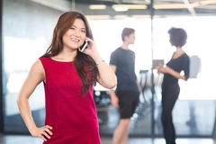 Young woman talking on mobile phone Royalty Free Stock Photos