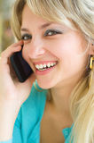 Young woman talking on mobile phone. Closeup portrait of a young smiling pretty woman talking on mobile phone Royalty Free Stock Photo