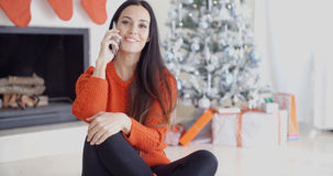 Young woman talking on a mobile phone Stock Images