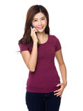 Young woman talking by mobile phone Royalty Free Stock Photo