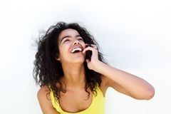 Young woman talking on mobile phone and laughing Royalty Free Stock Image