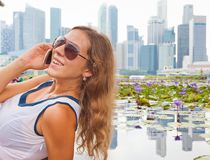 Young woman talking by mobile phone Stock Images