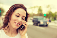 Young woman talking on mobile phone outdoors Royalty Free Stock Photo