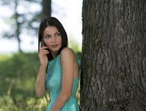 Young woman talking on mobile phone in park Royalty Free Stock Photo