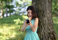 Young woman talking on mobile phone in park Royalty Free Stock Photography