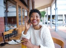 Young woman talking on mobile phone at restaurant Royalty Free Stock Photos