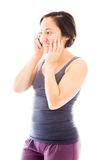Young woman talking on mobile phone and smiling Royalty Free Stock Images