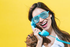 Young woman talking on old fashion phone Stock Photo