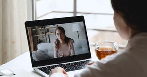 Young woman talking with online psychologist during webcam counseling consultation
