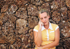 Young woman talking over her mobile phone Royalty Free Stock Image
