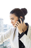 Young woman talking over phone Stock Photos