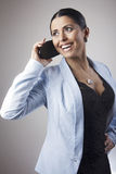 Young woman talking over the phone Royalty Free Stock Images